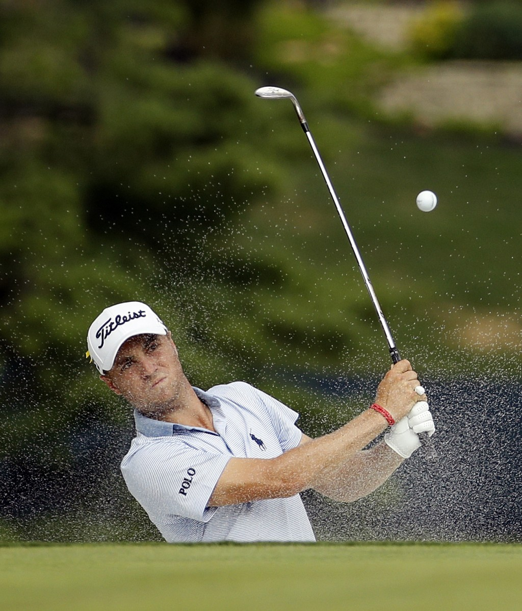 Justin Thomas hits from a bunker onto the 14th green during the final round of the PGA Championship golf tournament at Bellerive Country Club, Sunday,...