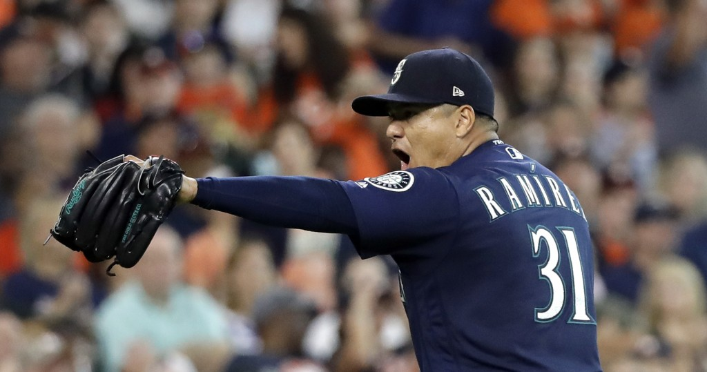 Seattle Mariners starting pitcher Erasmo Ramirez reacts after his team turned a double play to end the fifth inning of a baseball game against the Hou