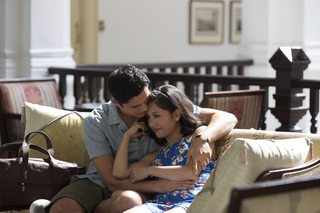 """This image released by Warner Bros. Entertainment shows Henry Golding, left, and Constance Wu in a scene from """"Crazy Rich Asians."""" (Warner Bros. Enter..."""