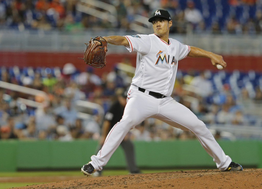 Miami Marlins starting pitcher Wei-Yin Chen throws against the New York Mets in the fifth inning during their baseball game in Miami, Sunday, Aug. 12,