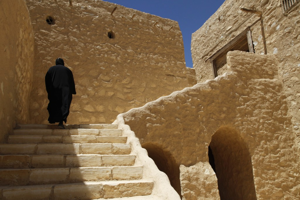 FILE- In this April 16, 2013 photo, a monk walks on the grounds of the ancient monastery of St. Anthony, southeast of Cairo, Egypt. The killing of a r...