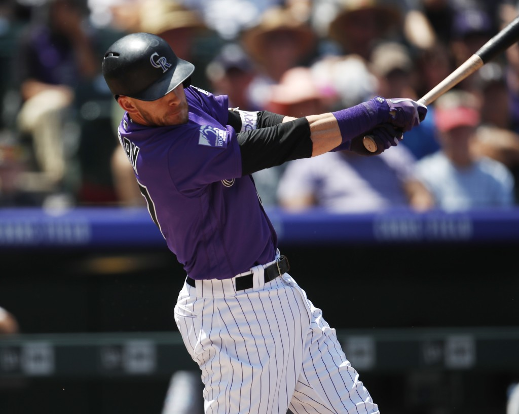 Colorado Rockies' Trevor Story connects for a sacrifice fly to bring in a run off Los Angeles Dodgers starting pitcher Rich Hill in the first inning o
