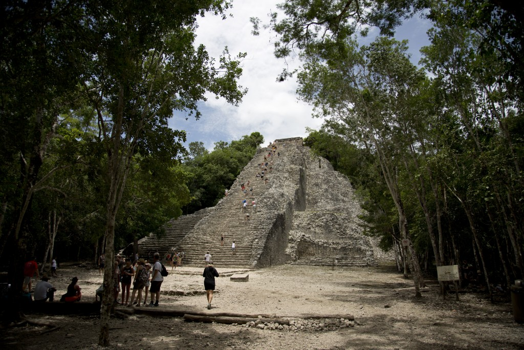In this Aug. 1, 2018 photo, tourists climb the pyramid at the archeological site of Coba on Mexico's Yucatan Peninsula. Mexico's president-elect Andre...