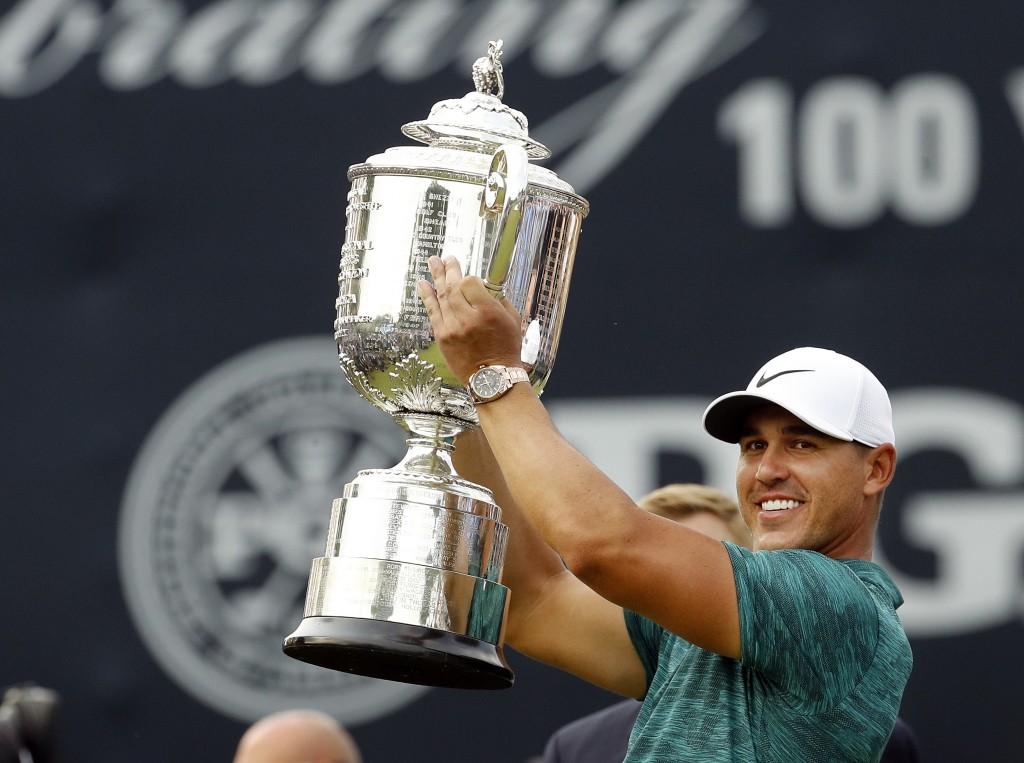 Brooks Koepka lifts the Wanamaker Trophy after winning the PGA Championship golf tournament at Bellerive Country Club, Sunday, Aug. 12, 2018, in St. L