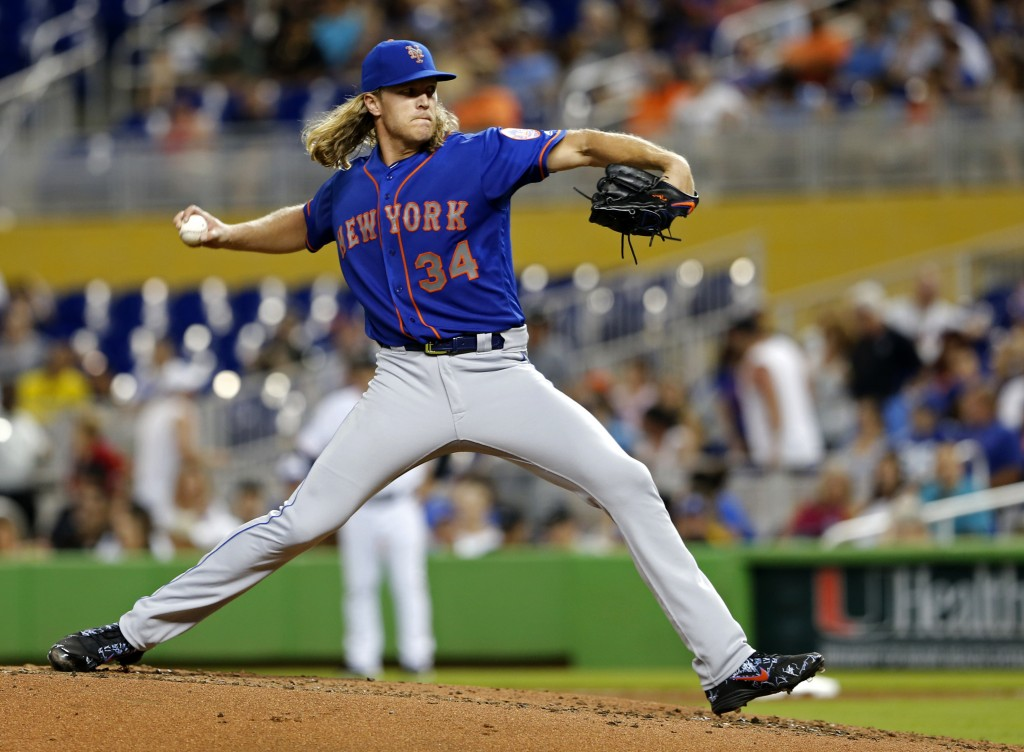 New York Mets starting pitcher Noah Syndergaard throws against the Miami Marlins in the fourth inning during their baseball game in Miami, Sunday, Aug