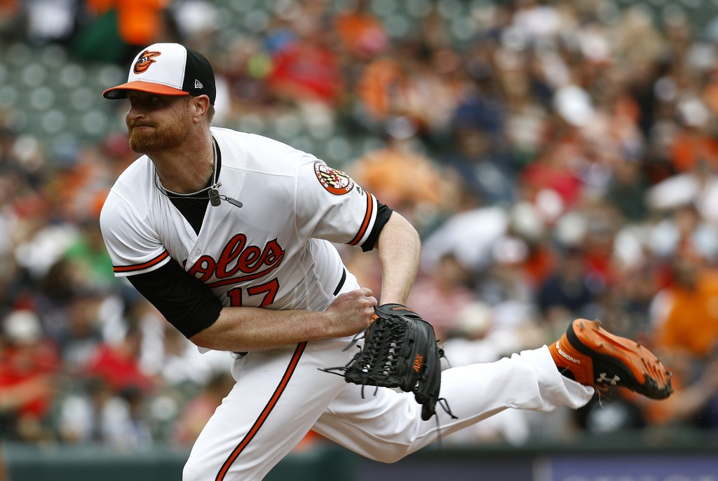 Baltimore Orioles starting pitcher Alex Cobb follows through on a pitch to the Boston Red Sox in the second inning of a baseball game, Sunday, Aug. 12