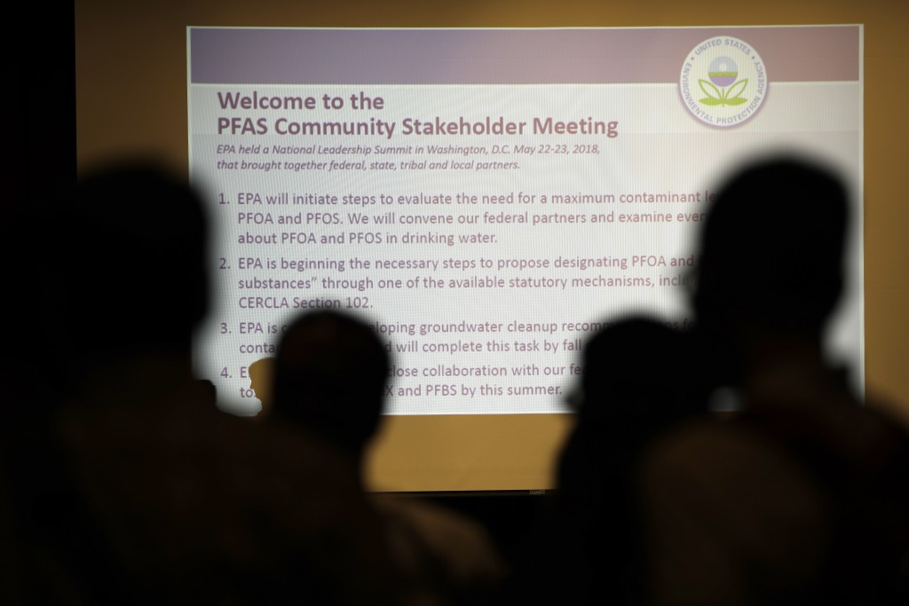 In this July 25, 2018 photo people attend the PFAS Community Stakeholder Meeting, on in Horsham, Pa. In Horsham and surrounding towns in eastern Penns...