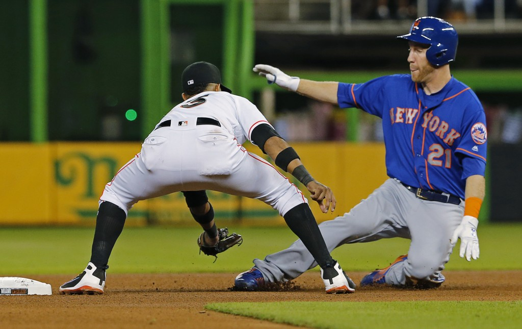 Miami Marlins second baseman Starlin Castro (13) tags out New York Mets' Todd Frazier (21) after Frazier tried to stretch a single in the fourth innin