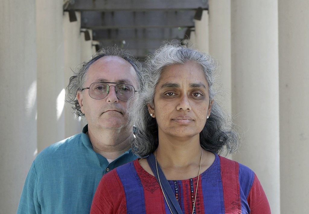 In this July 25, 2018 photo, Kalyanaraman Shankari, right, and her husband Thomas Raffill pose for photos in Mountain View, Calif. An Associated Press...