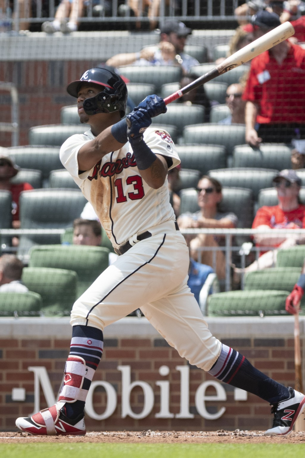 Atlanta Braves' Ronald Acuna Jr. watches his home run ball sail toward left field during the second inning of a baseball game against the Milwaukee Br