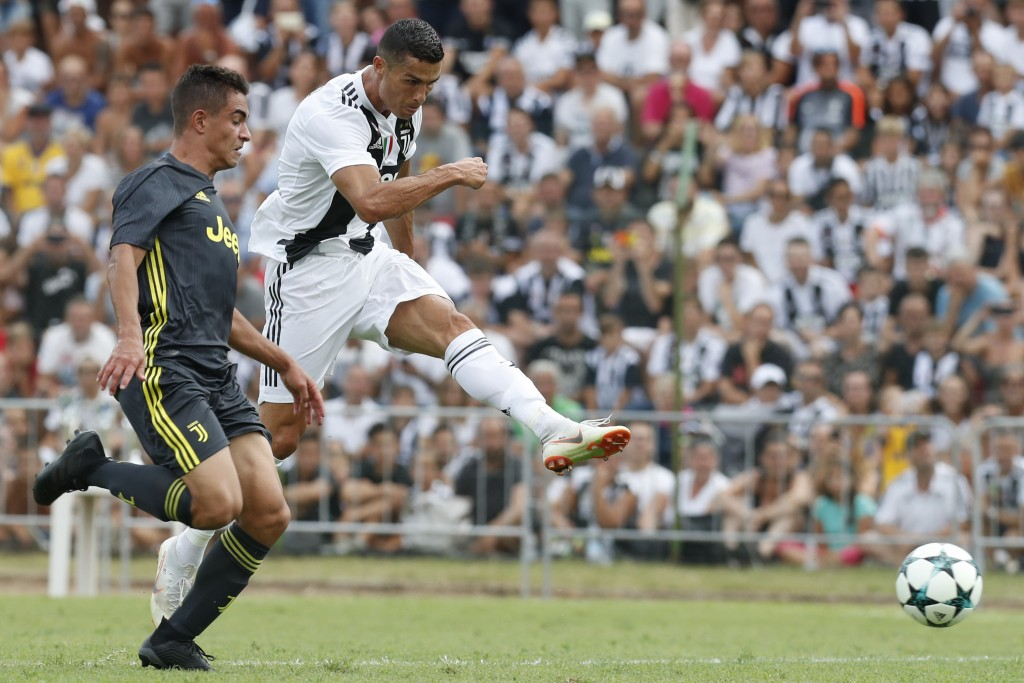 FILE - In this Sunday, Aug.12, 2018 filer, Juventus' Cristiano Ronaldo, right, controls the ball during a friendly match between the Juventus A and B ...
