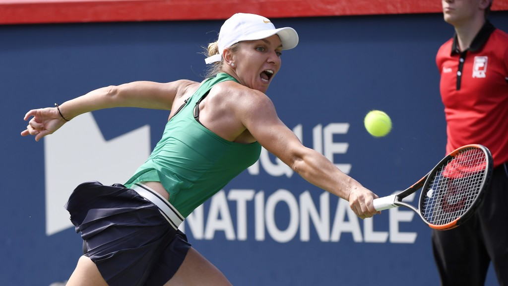 Simona Halep of Romania returns to Sloane Stephens of the United States during the final of the Rogers Cup tennis tournament Sunday, Aug. 12, 2018 in