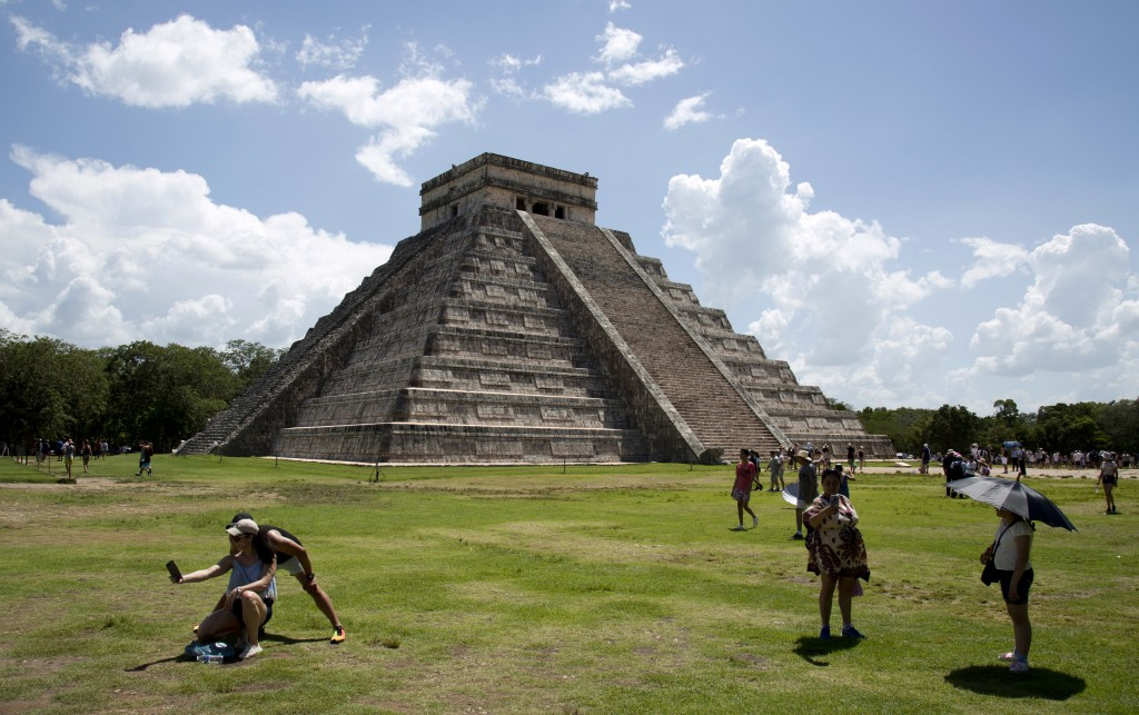 In this Aug. 3, 2018 photo, tourists walk at the Mayan ruins of Chichen Itza in Mexico's Yucatan Peninsula. Mexico's president-elect Andres Manuel Lop...