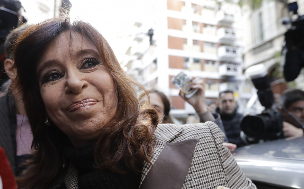 Former President Cristina Fernandez gets into a car to be transported to a court hearing, in Buenos Aires, Argentina, Monday, Aug. 13, 2018. Fernandez...