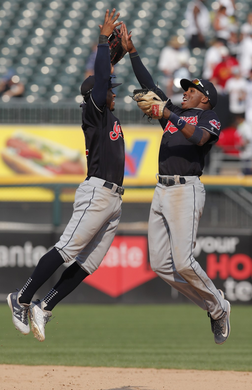 Cleveland Indians' Francisco Lindor, left, and Cleveland Indians' Greg Allen celebrate their victory over the Chicago White Sox after a baseball game
