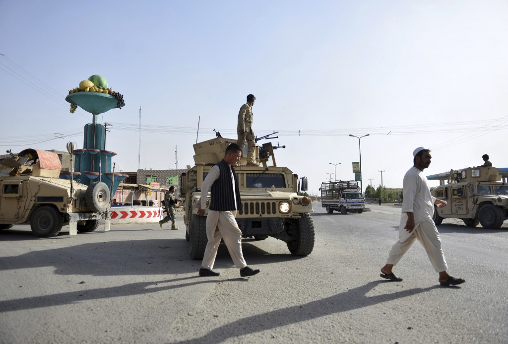 In this Sunday, Aug. 12, 2018, photo, Afghan Security personnel petrol in the city of Ghazni province, west of Kabul, Afghanistan. The United States h...