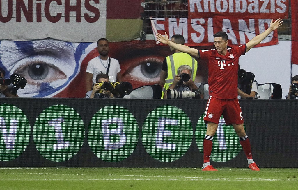 Munich's Robert Lewandowski celebrates his side's third goal during a soccer Supercup match between Eintracht Frankfurt and Bayern Munich In Frankfurt