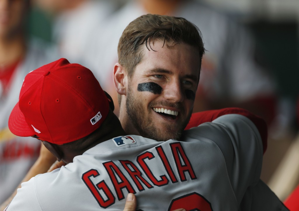 St. Louis Cardinals' Patrick Wisdom, right, is congratulated by Greg Garcia after scoring in his major league debut in the third inning of a baseball