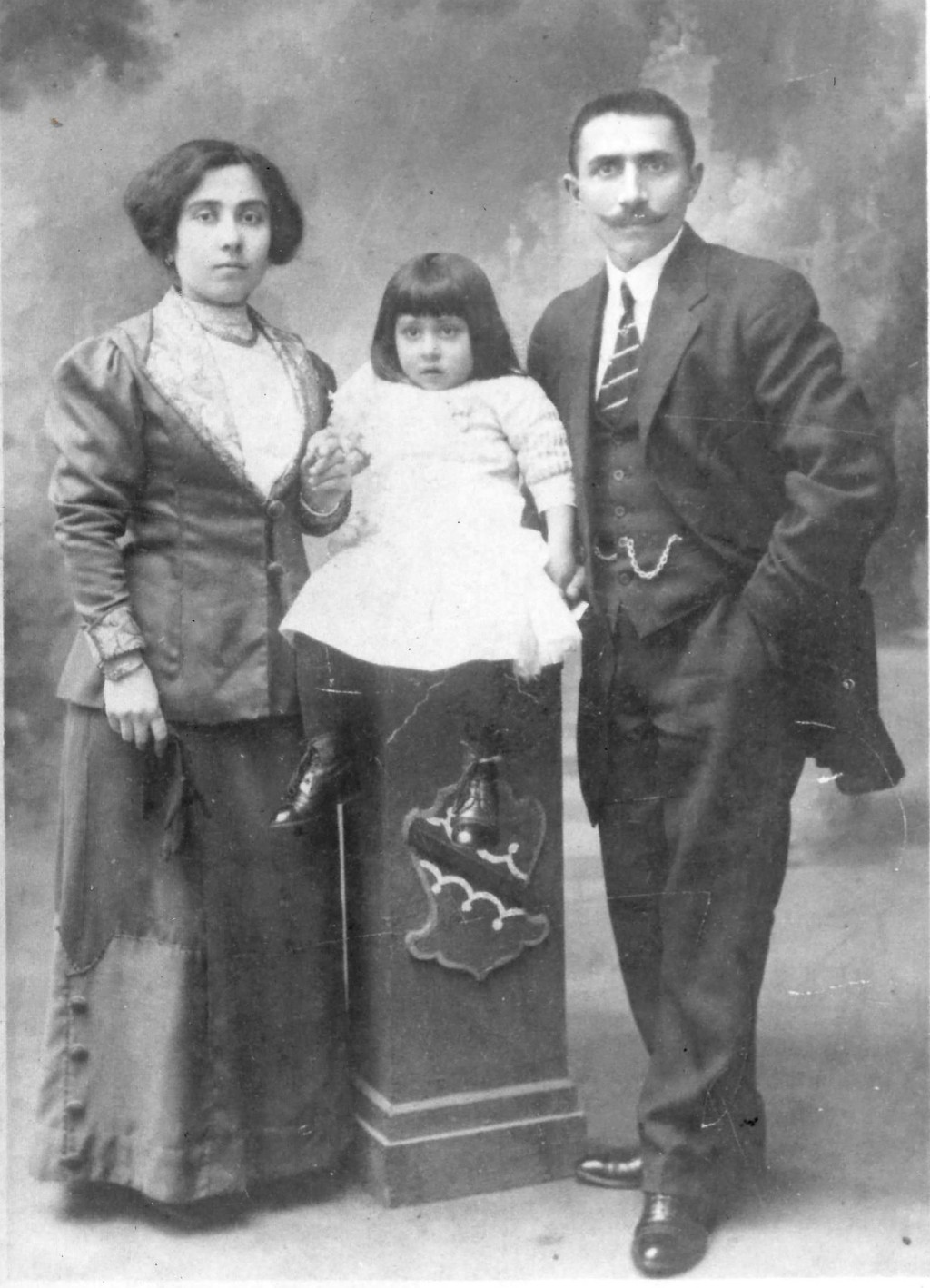 In this undated photo provided by the Ragucci family, Carmela and Nicola Ragucci pose with their daughter, Mary. Eight of the couple's sons served in ...