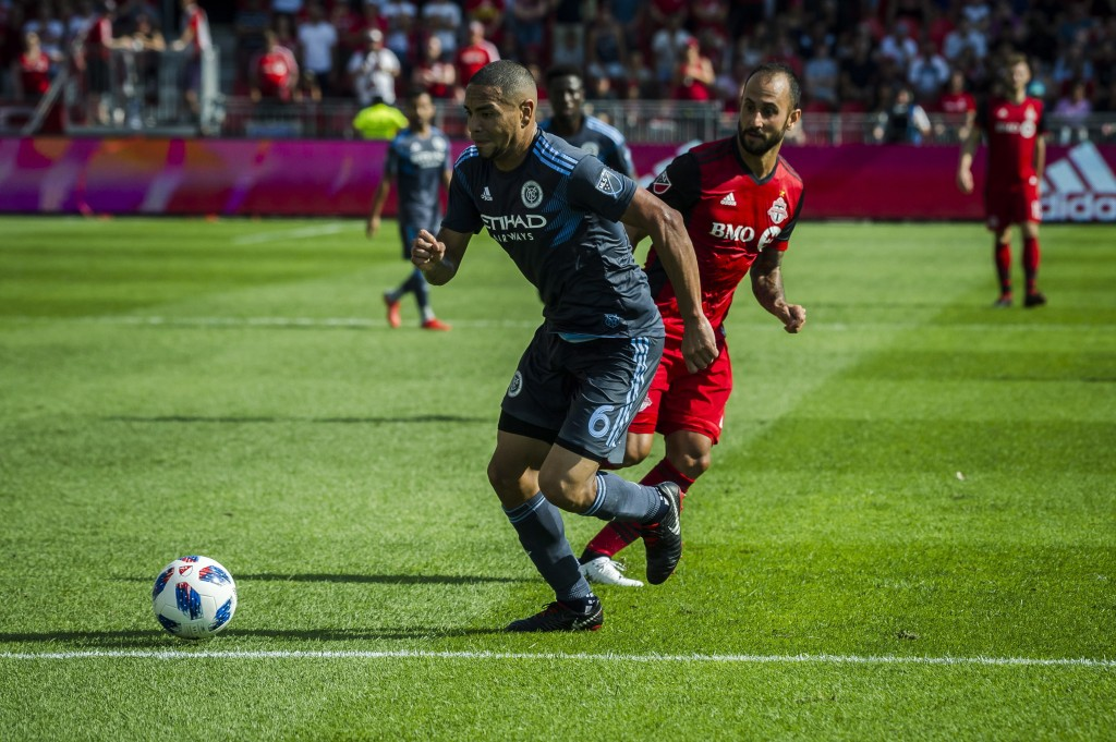 Toronto FC midfielder Victor Vazquez, right, and New York City FC defender Alexander Callens (6) fight for the ball during first-half MLS soccer game