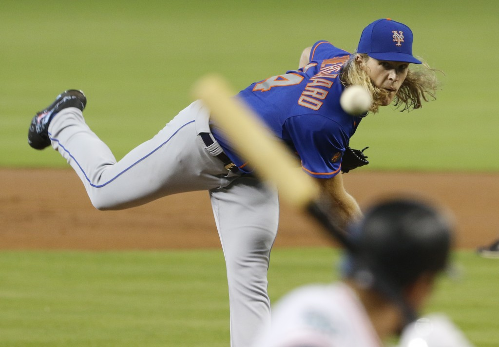 New York Mets starting pitcher Noah Syndergaard throws against the Miami Marlins in the first inning during their baseball game in Miami, Sunday, Aug.