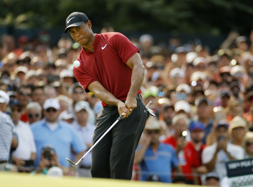 Tiger Woods chips onto 14th green during the final round of the PGA Championship golf tournament at Bellerive Country Club, Sunday, Aug. 12, 2018, in ...