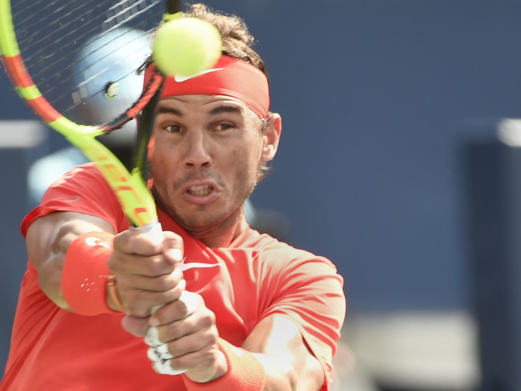 Rafael Nadal, of Spain, returns to Stefanos Tsitsipas, of Greece, during the final of the Rogers Cup men's tennis tournament in Toronto, Sunday, Aug.