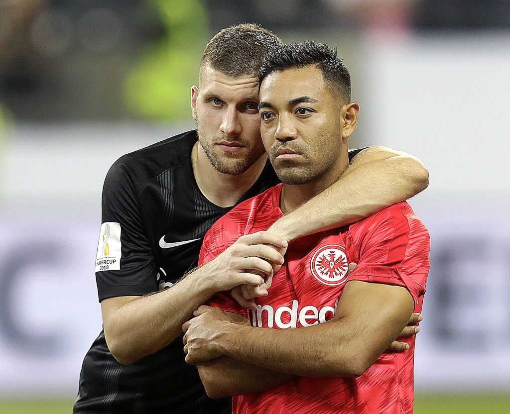 Frankfurt's Ante Rebic, left, and Marco Fabian comfort each other after a soccer Supercup match between Eintracht Frankfurt and Bayern Munich In Frank