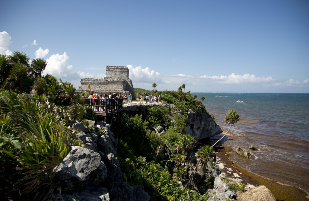 In this Aug. 5, 2018 photo, tourists vist the archeological site of Tulum on Mexico's Yucatan Peninsula. Almost seven million international tourists v...
