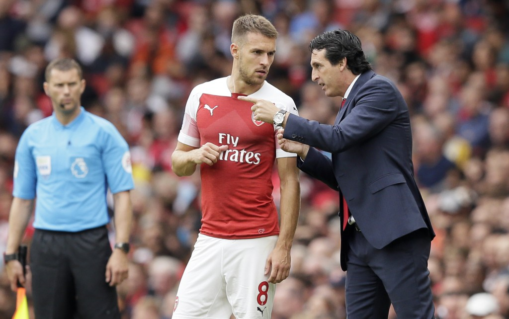 Arsenal manager Unai Emery gives instructions to Arsenal's Aaron Ramsey during the English Premier League soccer match between Arsenal and Manchester ...