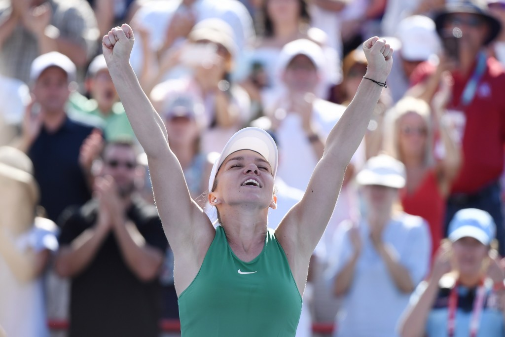 Simona Halep of Romania reacts after defeating Sloane Stephens of the United States to win the final of the Rogers Cup tennis tournament Sunday, Aug.