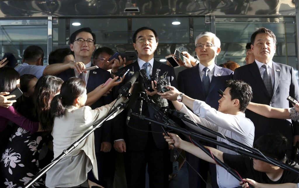South Korean Unification Minister Cho Myoung-gyon, center, speaks to the media before leaving for the border village of Panmunjom to attend a meeting ...