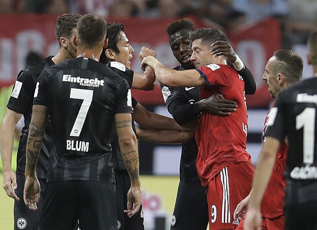 Munich's Robert Lewandowski, right, has an argument with Frankfurt players during a soccer Supercup match between Eintracht Frankfurt and Bayern Munic