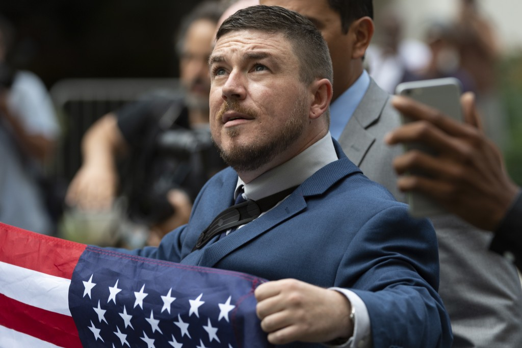 "Jason Kessler marches with other white nationalists to Lafayette Square during the ""Unite the Right 2"" rally in Washington, Sunday, Aug. 12, 2018. (Cr"