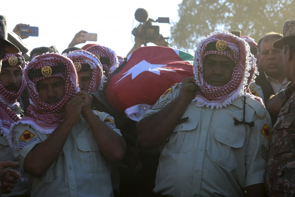 Jordanian soldiers and relatives of Sergeant Hisham al-Agarbeh, who was killed during an attack in the predominantly Christian town of Fuheis yesterda...