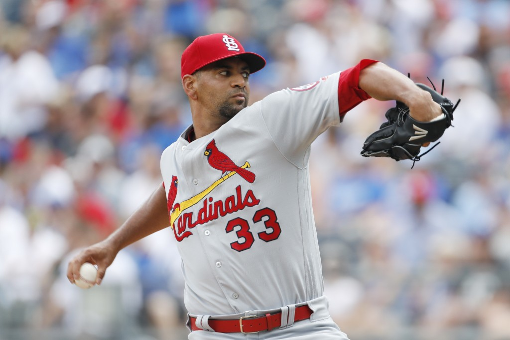 St. Louis Cardinals pitcher Tyson Ross throws to a Kansas City Royals batter in the first inning of a baseball game at Kauffman Stadium in Kansas City