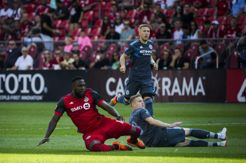 Toronto FC forward Jozy Altidore (17) is tackled by New York City FC midfielder Alexander Ring (8) during first-half MLS soccer game action in Toronto