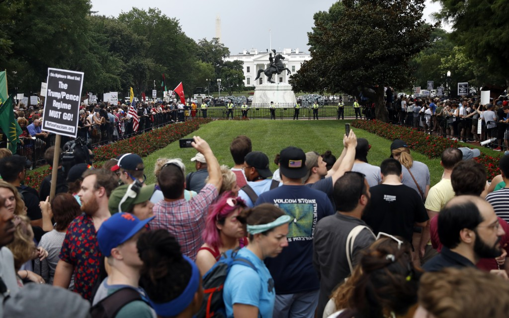 "Demonstrators rally near the White House on the one year anniversary of the Charlottesville ""Unite the Right"" rally, Sunday, Aug. 12, 2018, in Washing"