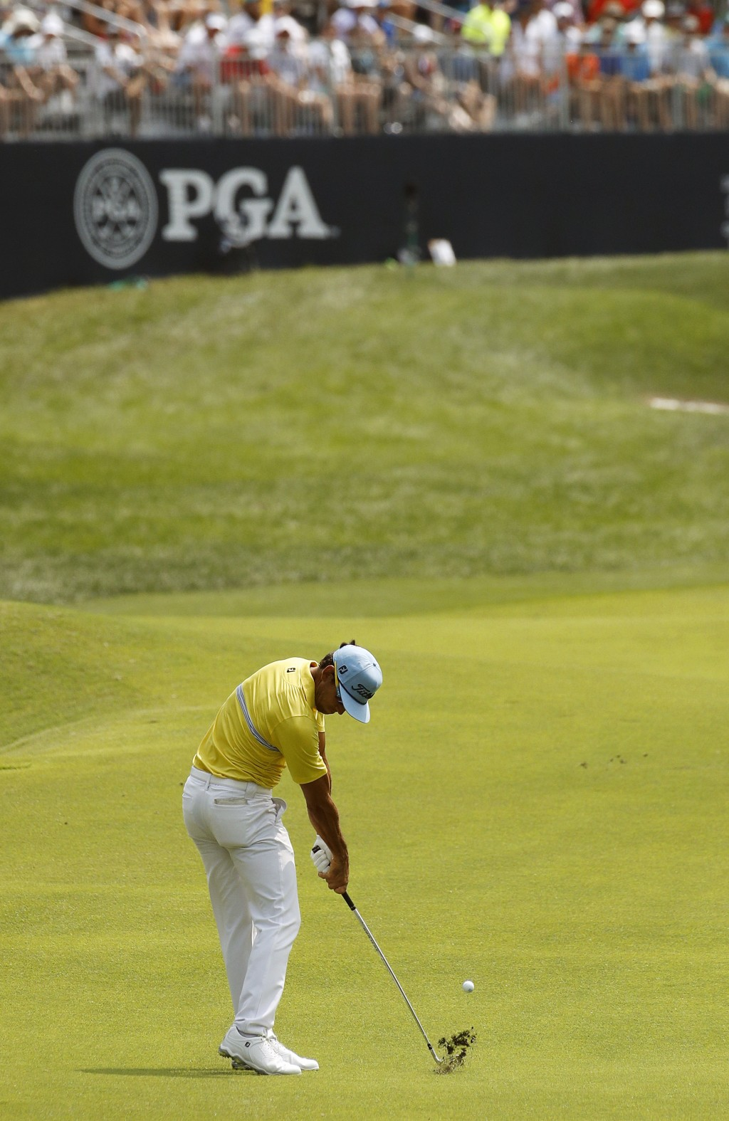 Rafa Cabrera Bello, of Spain, hits to the 17th green during the final round of the PGA Championship golf tournament at Bellerive Country Club, Sunday,...