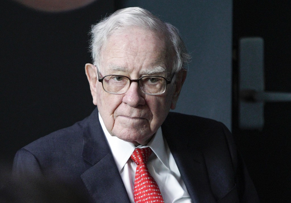 FILE- In this May 6, 2018, file photo Warren Buffett, chairman and CEO of Berkshire Hathaway, plays bridge outside Berkshire-owned Borsheims jewelry s...