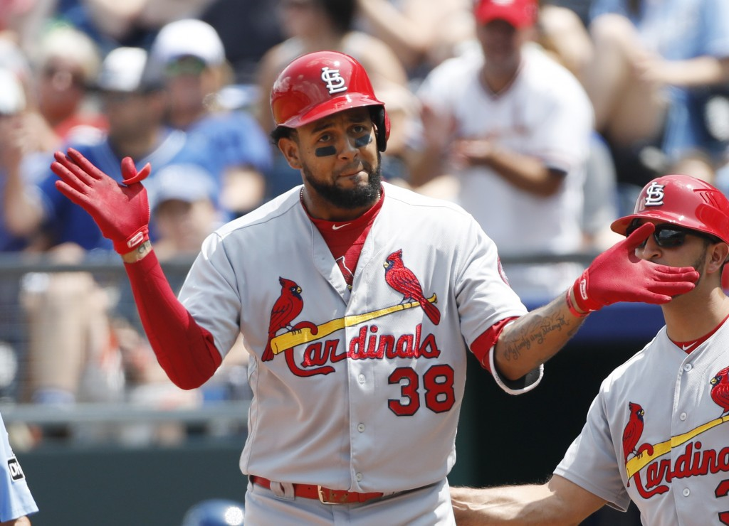 St. Louis Cardinals' Jose Martinez (38) reacts after hitting an RBI-single as first base coach Oliver Marmol looks on in the third inning of a basebal