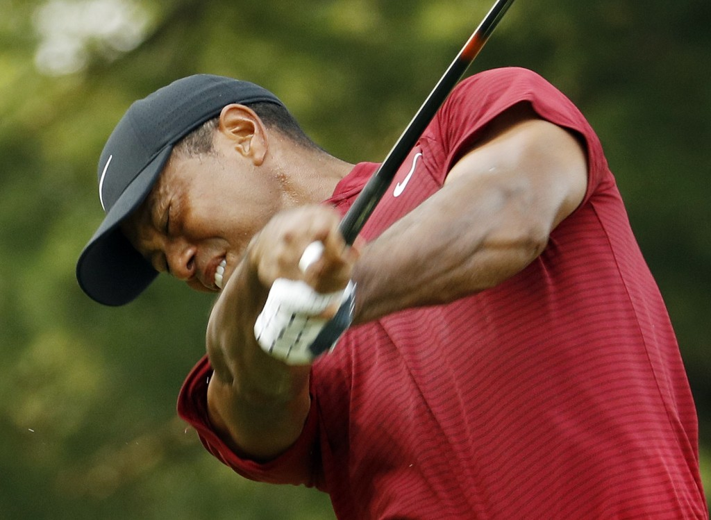 Tiger Woods hits from the 15th tee during the final round of the PGA Championship golf tournament at Bellerive Country Club, Sunday, Aug. 12, 2018, in