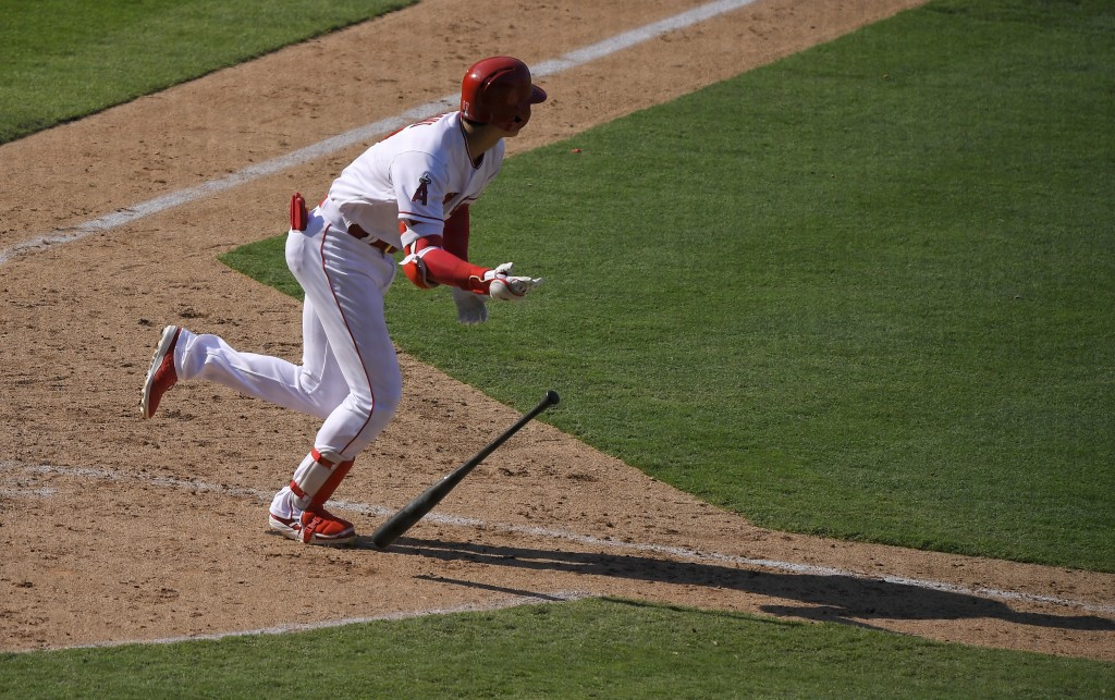 Los Angeles Angels' Shohei Ohtani, of Japan, drops his bat after hitting a two-RBI single during the eighth inning of a baseball game against the Oakl