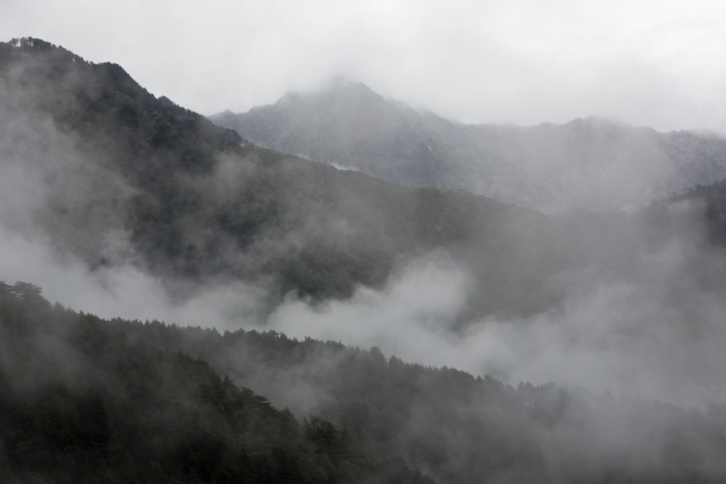 Rain clouds hang over the mountains in Dharmsala, India, Monday, Aug. 13, 2018. This region is currently receiving monsoon rains. (AP Photo/Ashwini Bh...