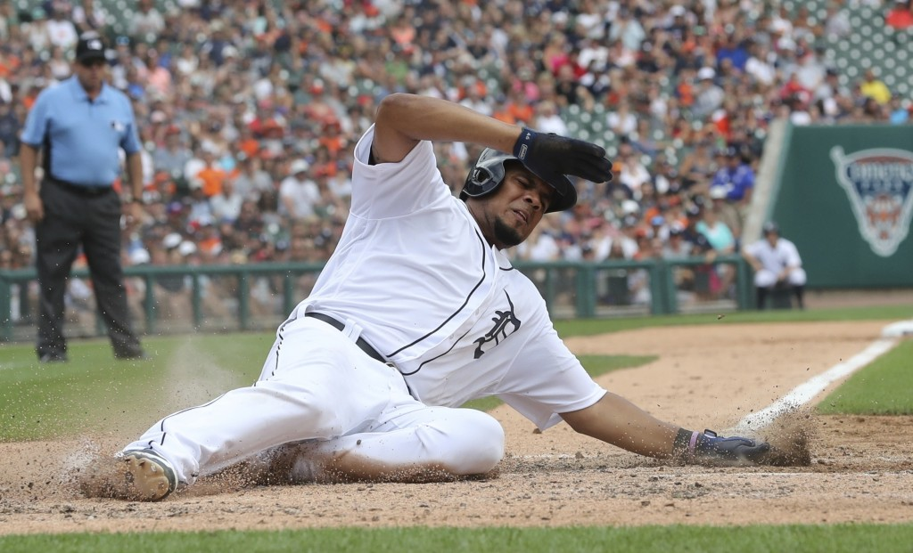 Detroit Tigers' Jeimer Candelario scores from third on a sacrifice by designated hitter Victor Martinez during the fifth inning of a baseball game  ag