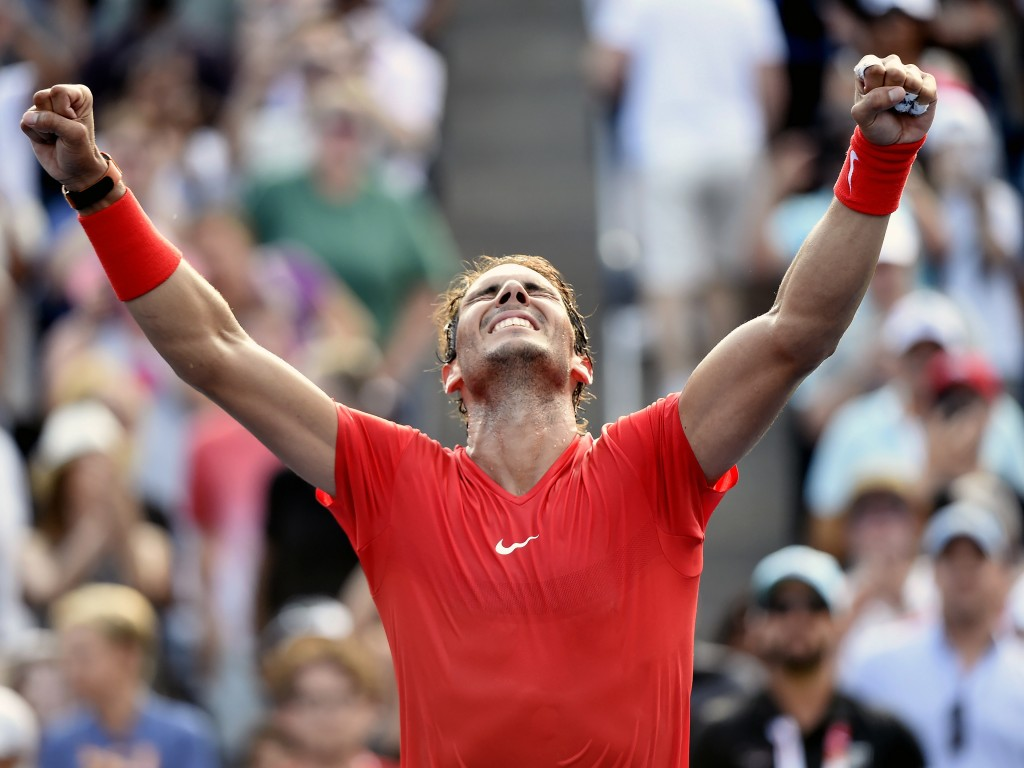 Rafael Nadal, of Spain, celebrates after defeating Stefanos Tsitsipas, of Greece, in the final of the Rogers Cup men's tennis tournament in Toronto, S...