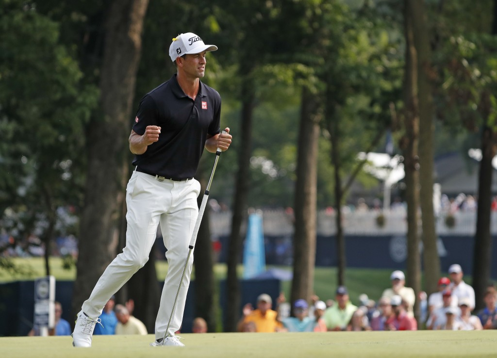 Adam Scott, of Australia, celebrates after making a birdie putt on the 10th green during the final round of the PGA Championship golf tournament at Be...