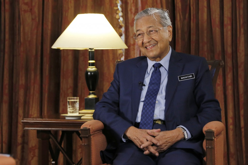 Malaysia's Prime Minister Mahathir Mohamad is interviewed in Putrajaya, Malaysia, Monday, Aug. 13, 2018. Mahathir said he will seek to cancel multibil...