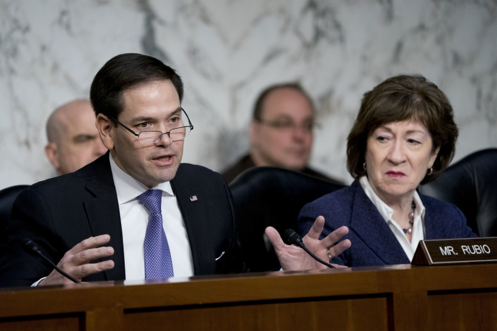 FILE - In this March 21, 2018, file photo, Sen. Marco Rubio, R-Fla., left, accompanied by Sen. Susan Collins, R-Maine, right, speaks as Homeland Secur...
