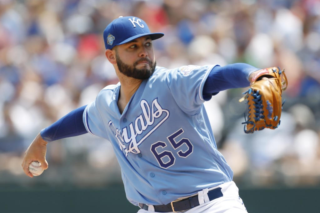 Kansas City Royals pitcher Jakob Junis throws to a St. Louis Cardinals batter in the first inning of a baseball game at Kauffman Stadium in Kansas Cit
